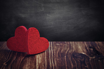 Valentines day background with two hearts on wooden background - Image