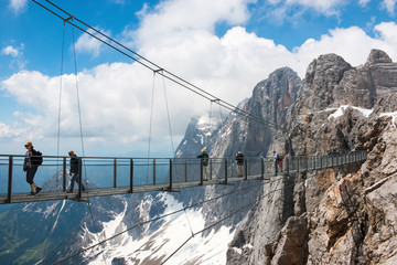 On peak of Dachstein and view alpine mountains