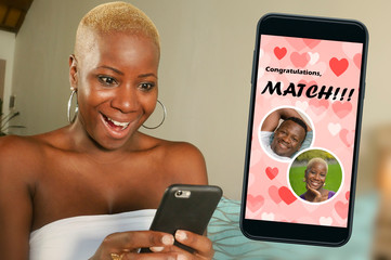 mobile phone and young beautiful and happy black afro American woman using online dating app...