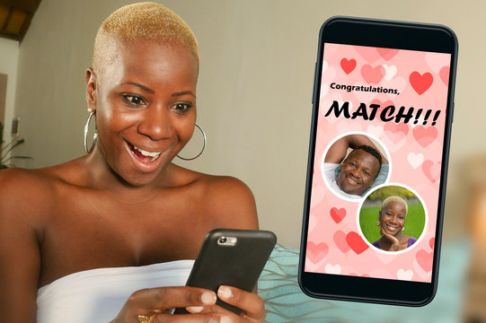 mobile phone and young beautiful and happy black afro American woman using online dating app excited in match with a handsome guy in internet relationship