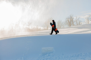 active sportsman is going to snowboarding in a frost sunny day . copy space. hobby, sport activity, leisure time