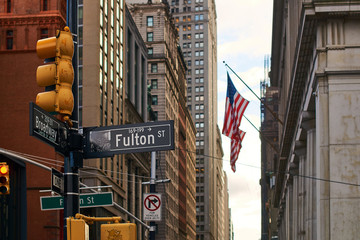 View of USA flag on Fulton Street in Lower Manhattan, NYC