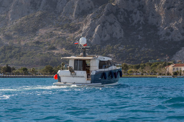 A luxurious powerboat cruising through beautiful blue waters