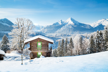 Traditional mountain hut in the Alps in winter