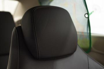 Leather headrest in modern car.