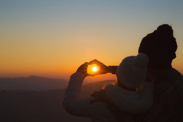 Couple in love, Focus on hands, Man and woman tourists in the mountains,  Happy couple in love,  Love couple, Love hug.
