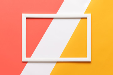 Abstract geometrical living coral, yellow and white paper flat lay background. Minimalism, geometry and symmetry template with empty picture frame mock up.