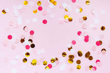 Valentines day, love pink greeting background. Flat lay with colorful dot pattern. Gold, red, pink and white circles. Romantic theme, bright abstract confetti template with space for text.