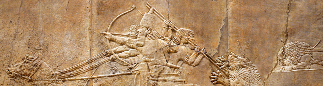 Assyrian wall relief of lion hunt, ancient history of Babylon and Shumer