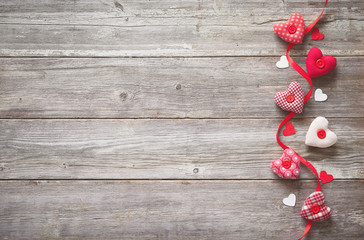 Valentines day background with handmade  textile hearts