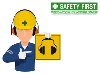 Industrial worker is presenting earmuffs sign