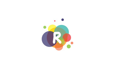 Bright and colorful image of the letter R, against the background of multicolored circles.