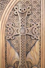 Cross carved on wooden door