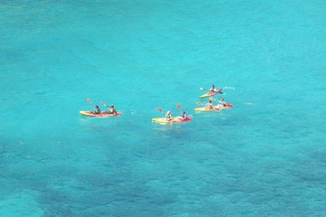 Kayak apprentices in a turquoise sea