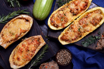 Stuffed eggplant and zucchini halves roasted with cheese