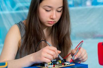 Girl in robotics laboratory.