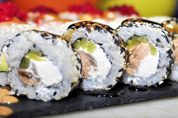 Foto op Aluminium Sushi bar Sushi set: sushi roll with salmon and sushi roll with smoked eel, selective focus.