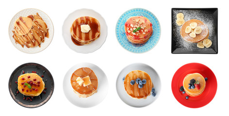 Set of plates with delicious pancakes and different toppings on white background, top view