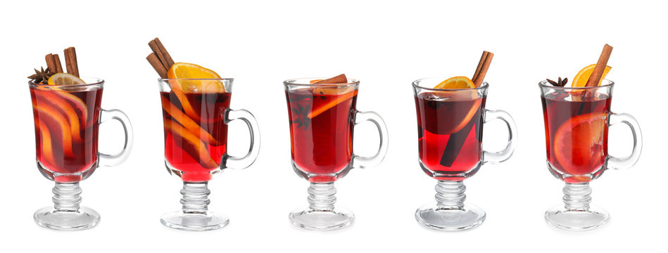 Set of traditional Christmas mulled wine in glasses on white background