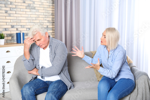 Mature couple arguing in living room  Relationship problems