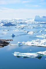 Ilulissat, Greenland, July | UNESCO world heritage site | impressions of Jakobshavn | Disko Bay Kangia Icefjord | huge icebergs in the blue sea on a sunny day | climate change - global warming