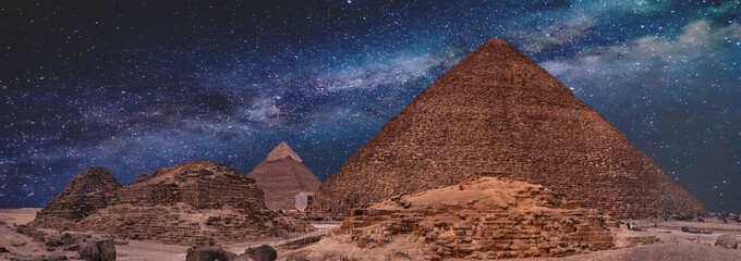 Night sky of the Milky Way over the great pyramids on the plateau of Giza, Egypt, Africa.
