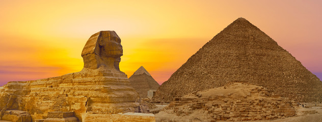 Sphinx against the backdrop of the great Egyptian pyramids. Africa, Giza Plateau. Wall mural