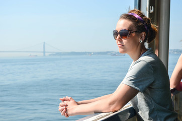 A female passenger on the Staten Island Ferry admires the view of the NYC skyline
