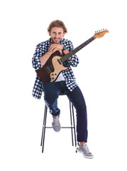 Young man with electric guitar on white background