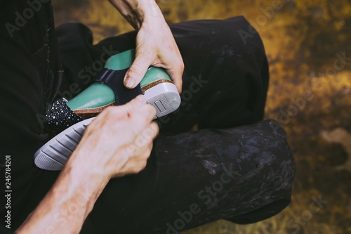 Hands making shoes  Making shoes manual  Shoemaker sitting in