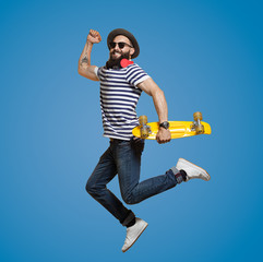 Modern Hipster jumoing on blue background