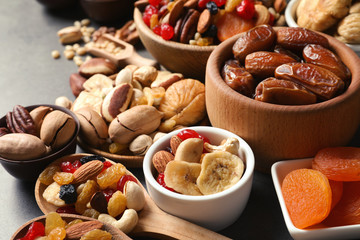 Composition of different dried fruits and nuts on table, closeup