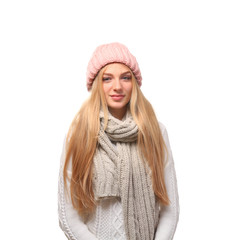 Portrait of beautiful young woman in stylish hat and sweater with scarf on white background. Winter atmosphere