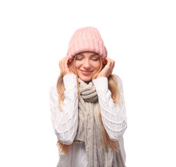 Portrait of emotional young woman in stylish hat and sweater with scarf on white background. Winter atmosphere