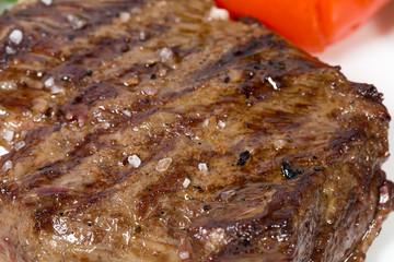 Grilled beef steak closeup.