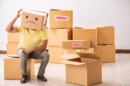 Unhappy man with box instead of his head