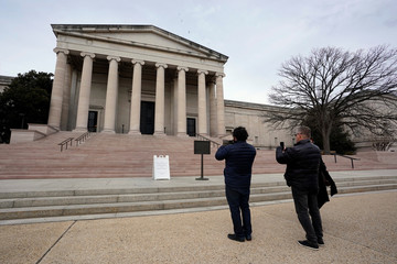 Tourists take pictures outside the National Gallery of Art in Washington