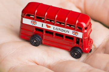 Fotobehang Londen rode bus I love London message on red bus, souvenir and symbol of London City, isolated on woman's hand