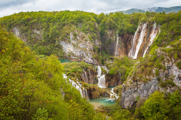 Breathtaking view of majestic waterfalls and green forests, Plitvice Lakes National Park, Croatia