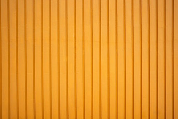 background of a wooden wall with orange vertical stripes