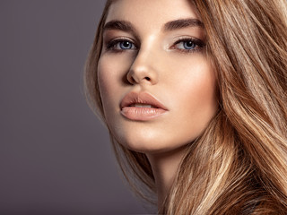 Woman with beauty long brown hair and natural makeup
