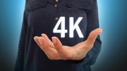 Businesswoman on blurred background holding hand 4K