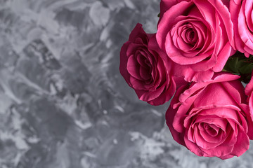 Romantic background. Red roses on a concrete table. Copy space. Top view. Flat lay