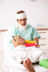Young injured man staying in the hospital