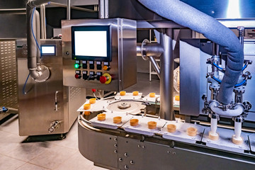 Ice cream making. Shop for the production of ice cream. Food industry. Dispenser. Food production line. Conveyor.  Dispenser  with remote control.