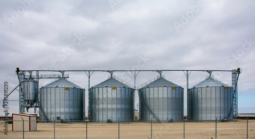 Grain silos on the side of the road