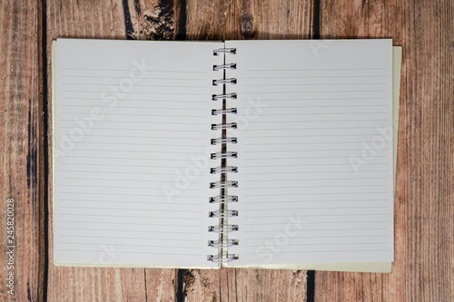 Open blank paper spiral lined notebook and bullet journal with no