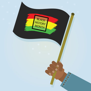 Hand holding waving Black History Month flag with proud as a celebration on blue gradient background