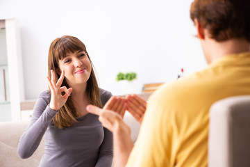 Woman and man learning sign language