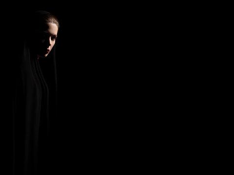 nun in dark